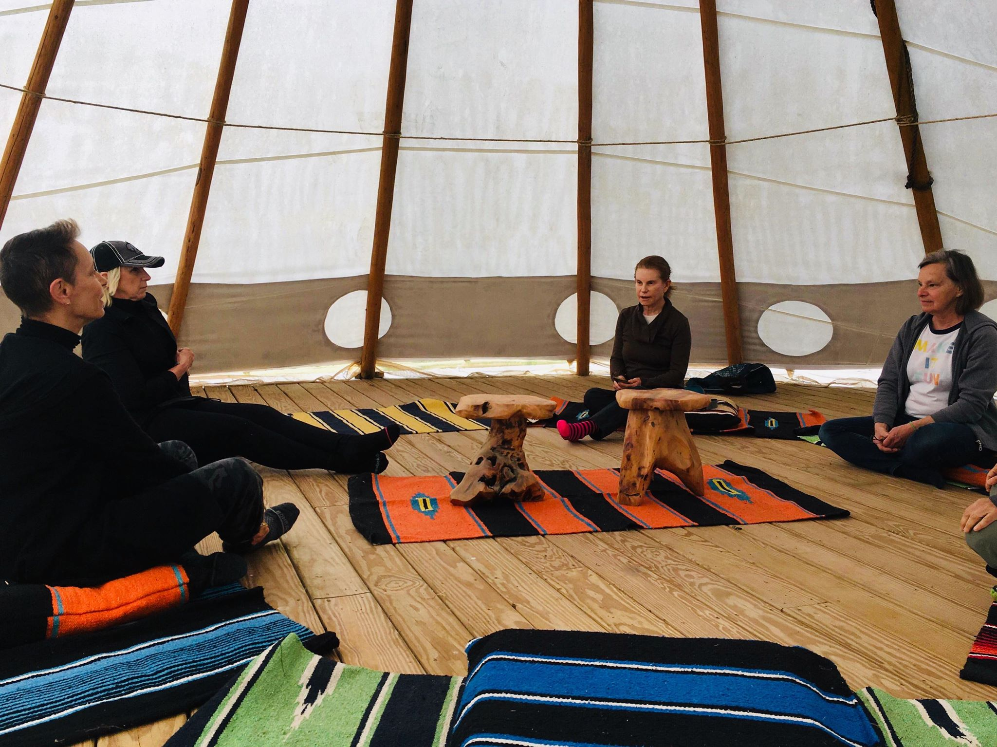 People gathering in a tipi