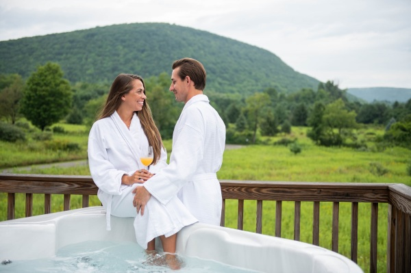 a couple finding romance and relaxation in a hot tub